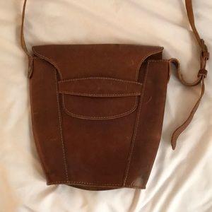 Distressed leather bucket bag. Crossbody.